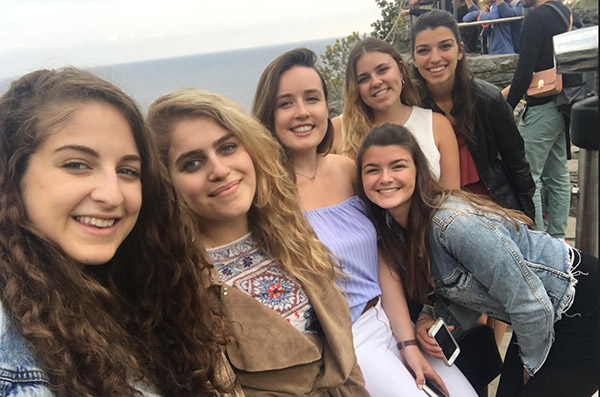 Victoria takes a selfie with 5 of her new friends while exploring Europe.